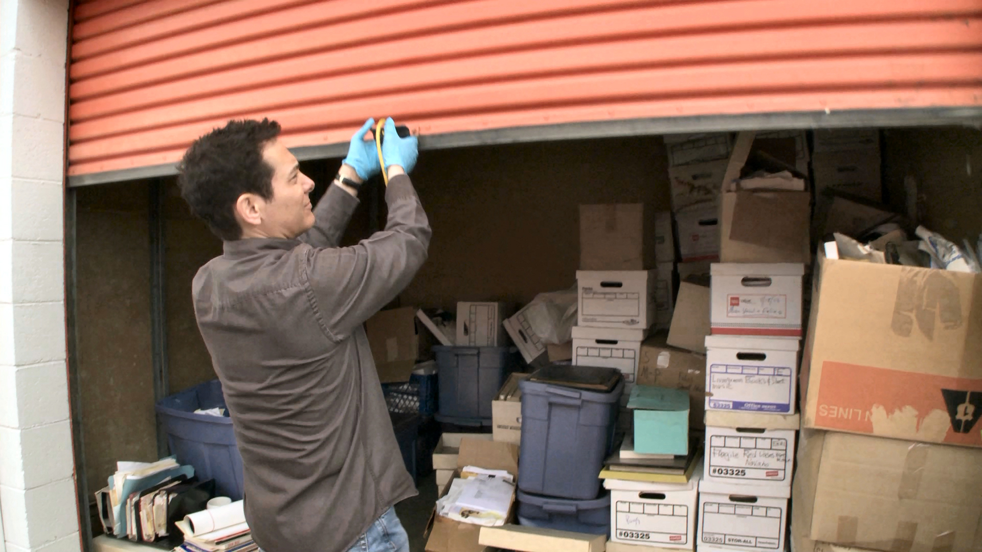 Feinstein examines the contents of one of his many storage lockers.